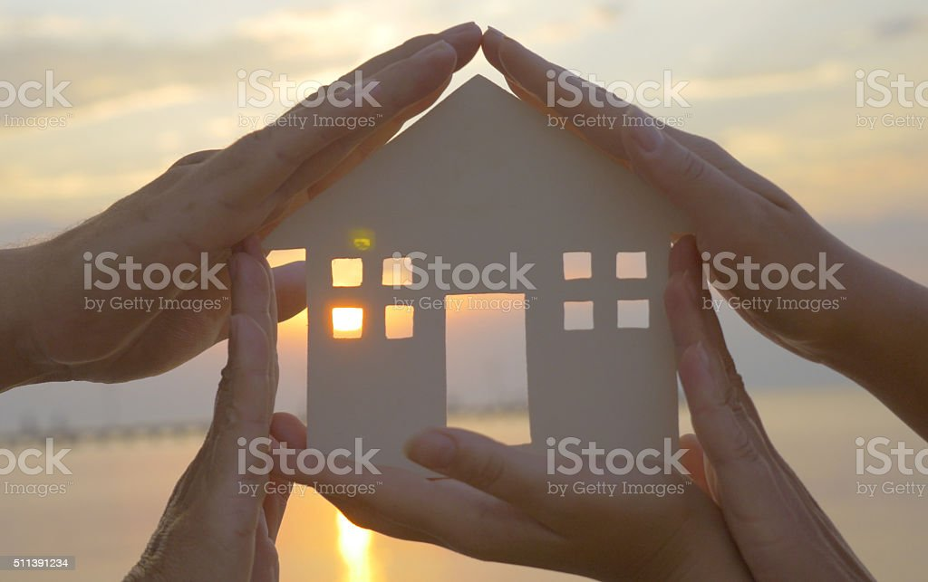 Hands on cut out house diagram stock photo
