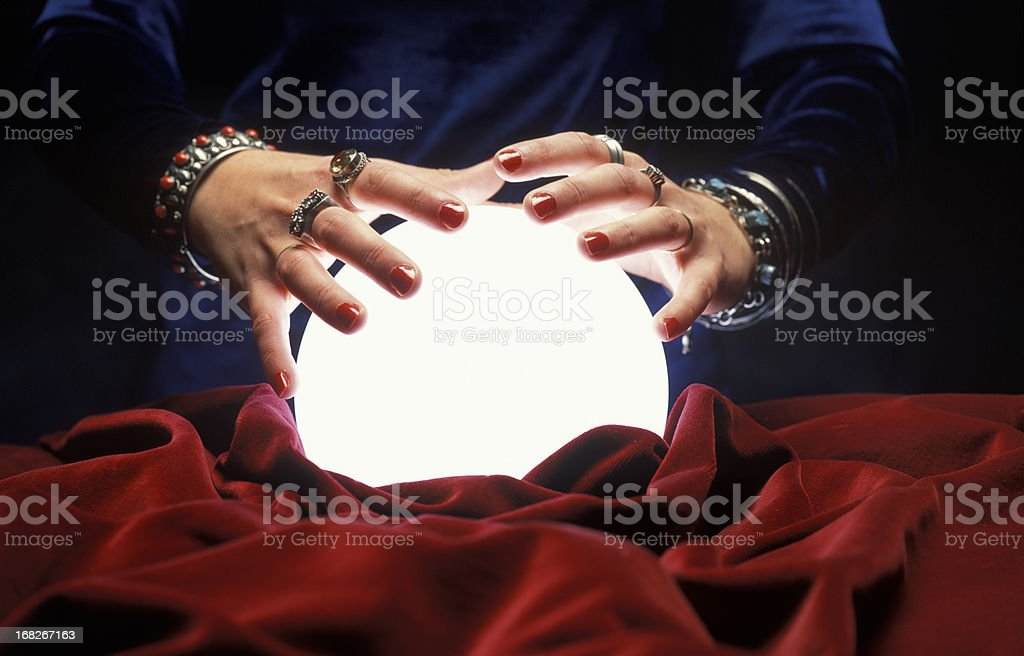 hands on glowing crystal ball stock photo