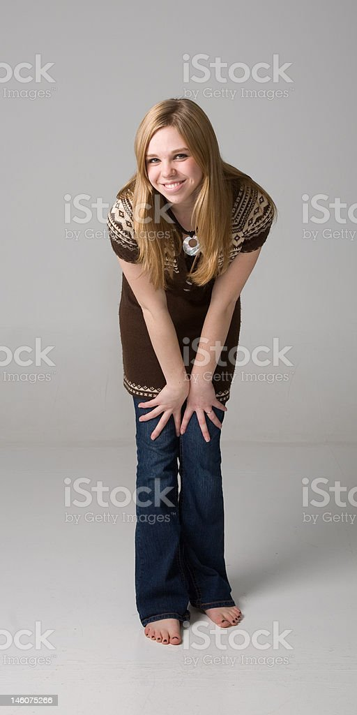 Hands on knees stock photo