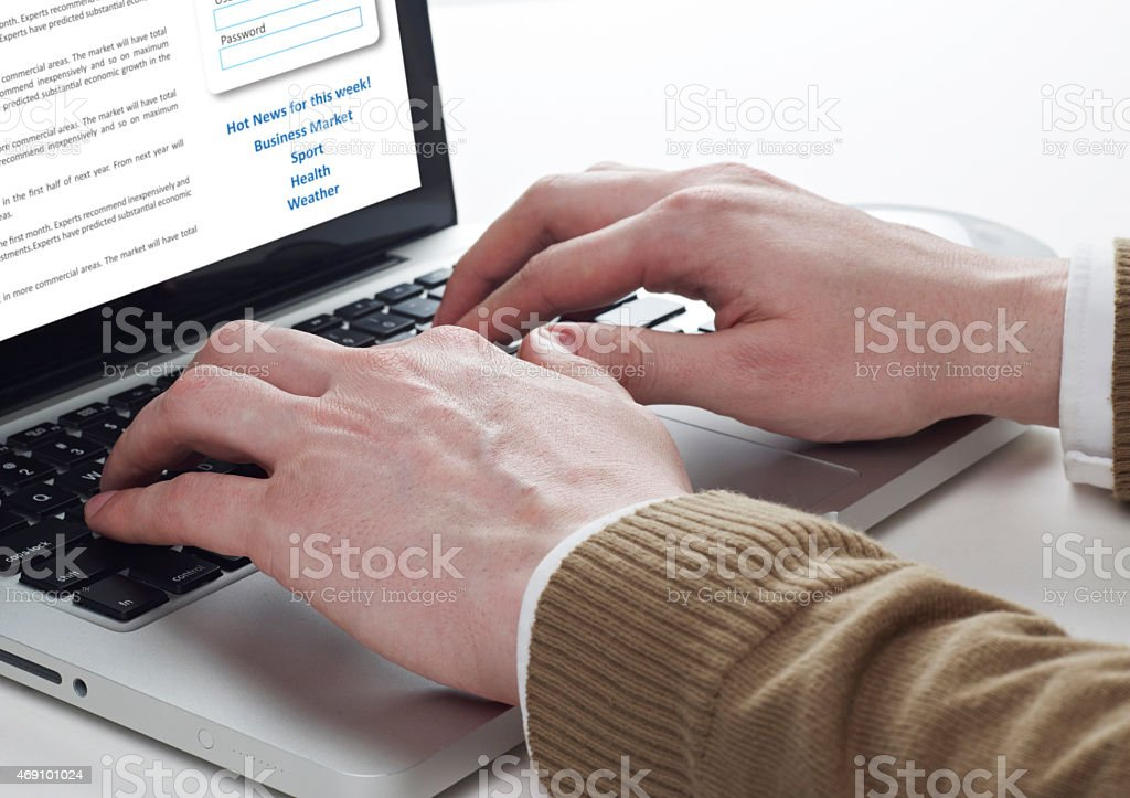 Hands on laptop stock photo