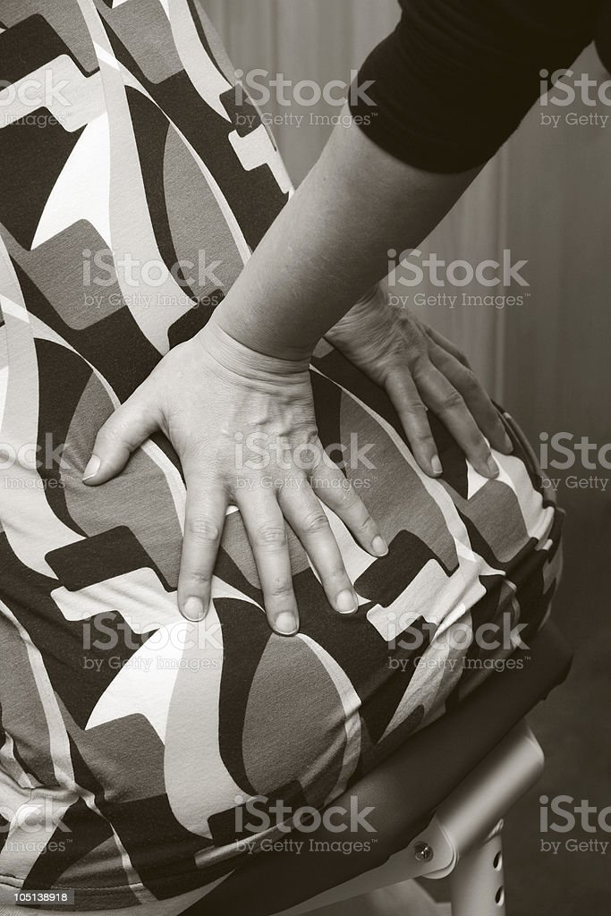 hands on lower back stock photo