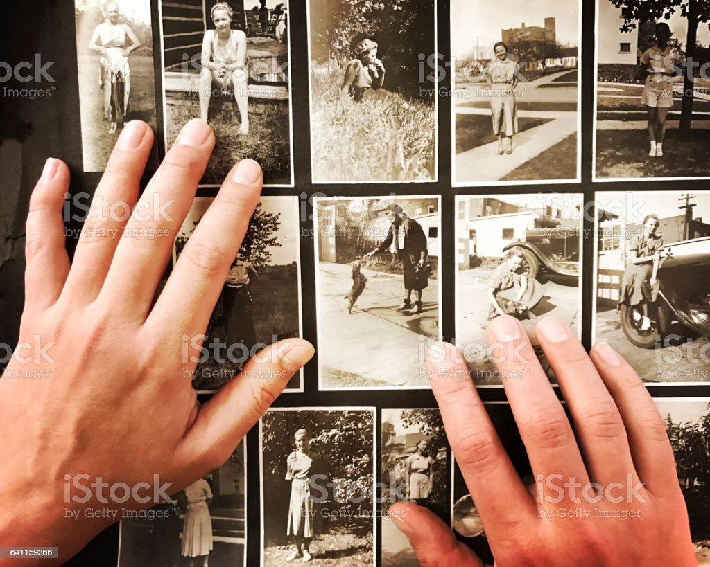 Hands on Old Photographs stock photo