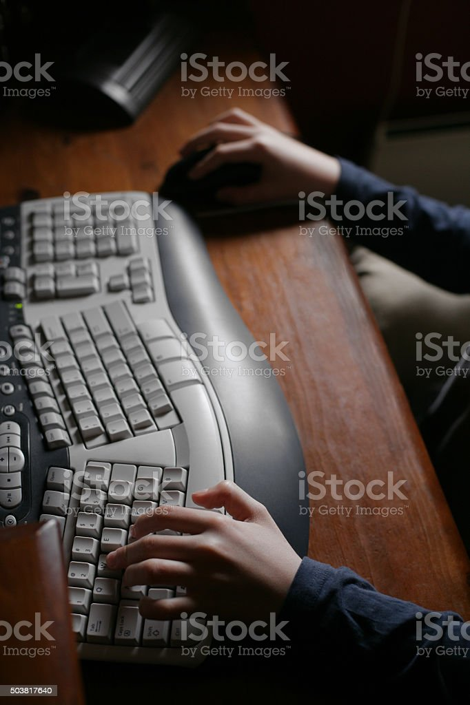 Hands on PC keyboard stock photo