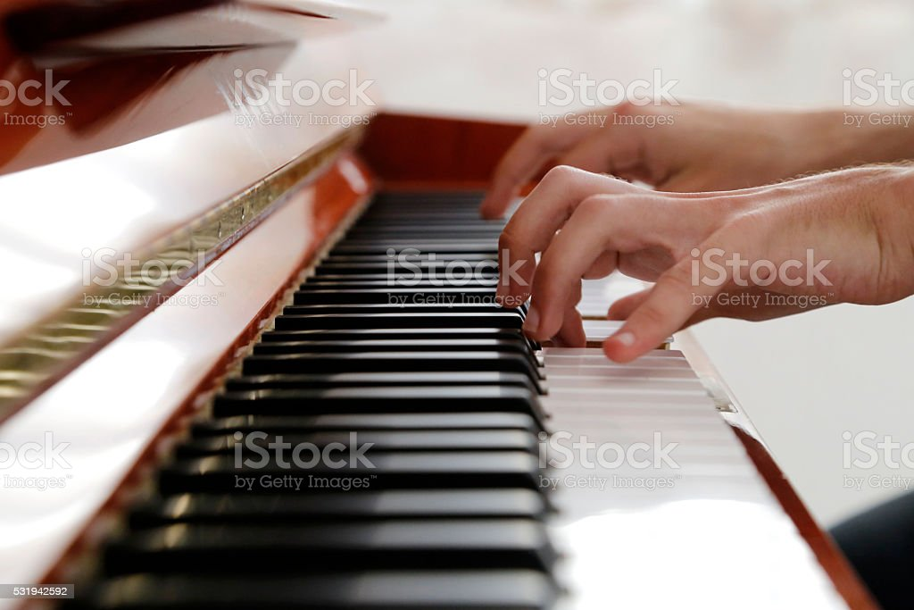 hands on piano stock photo