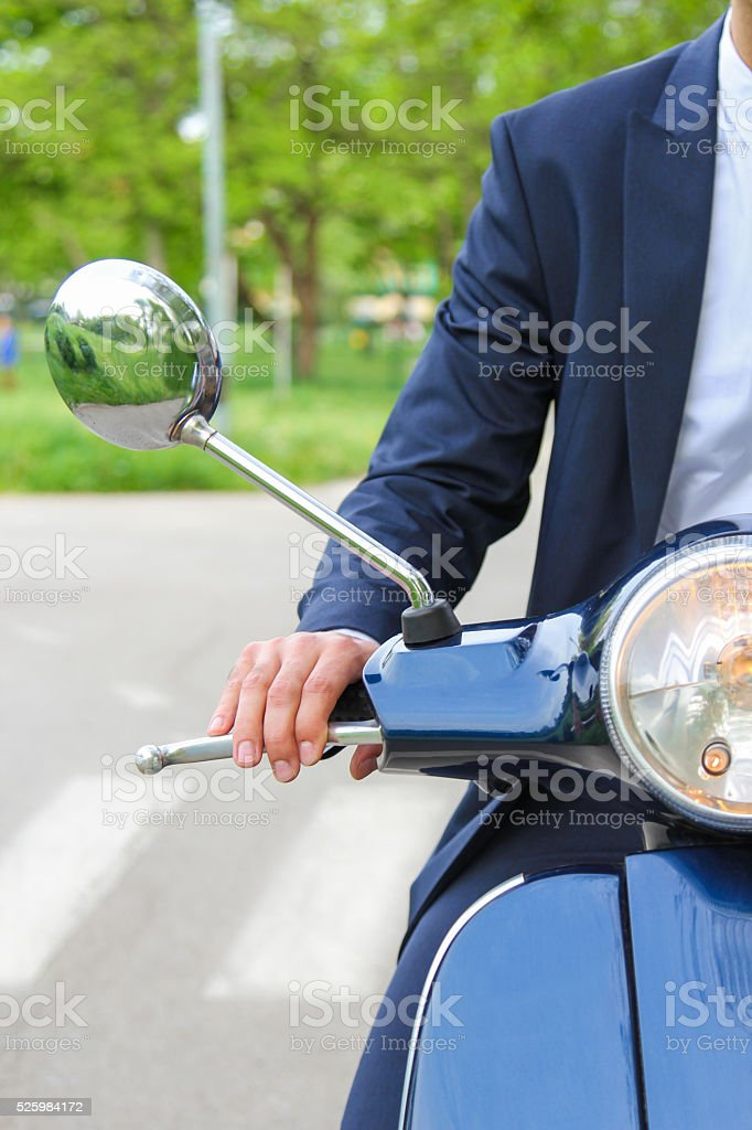 Hands on scooters handlebar stock photo