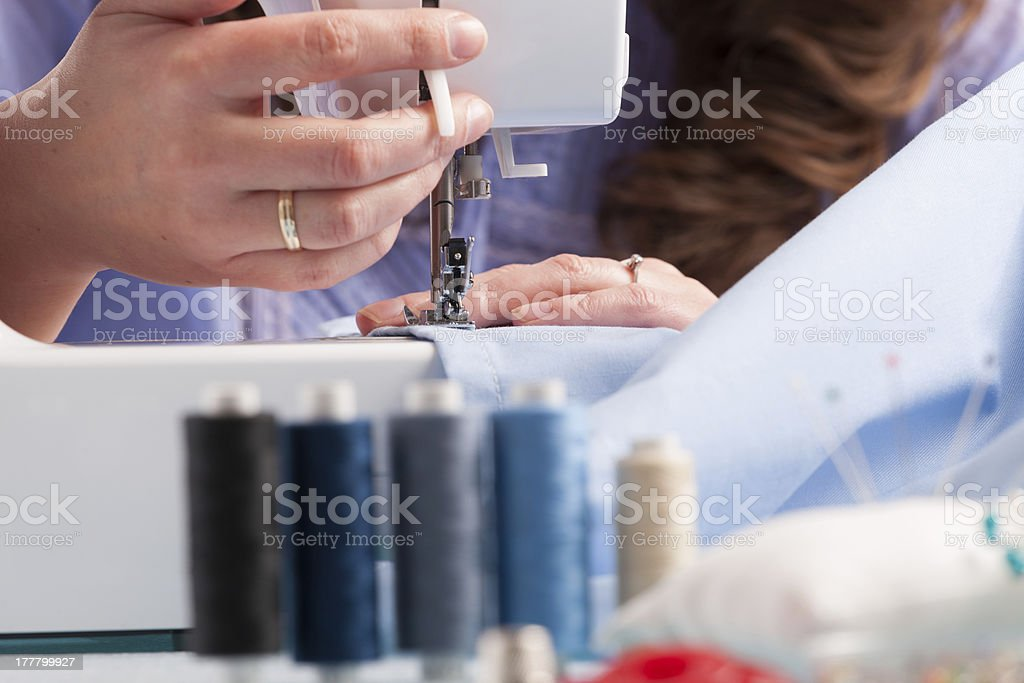 Hands on sewing machine royalty-free stock photo
