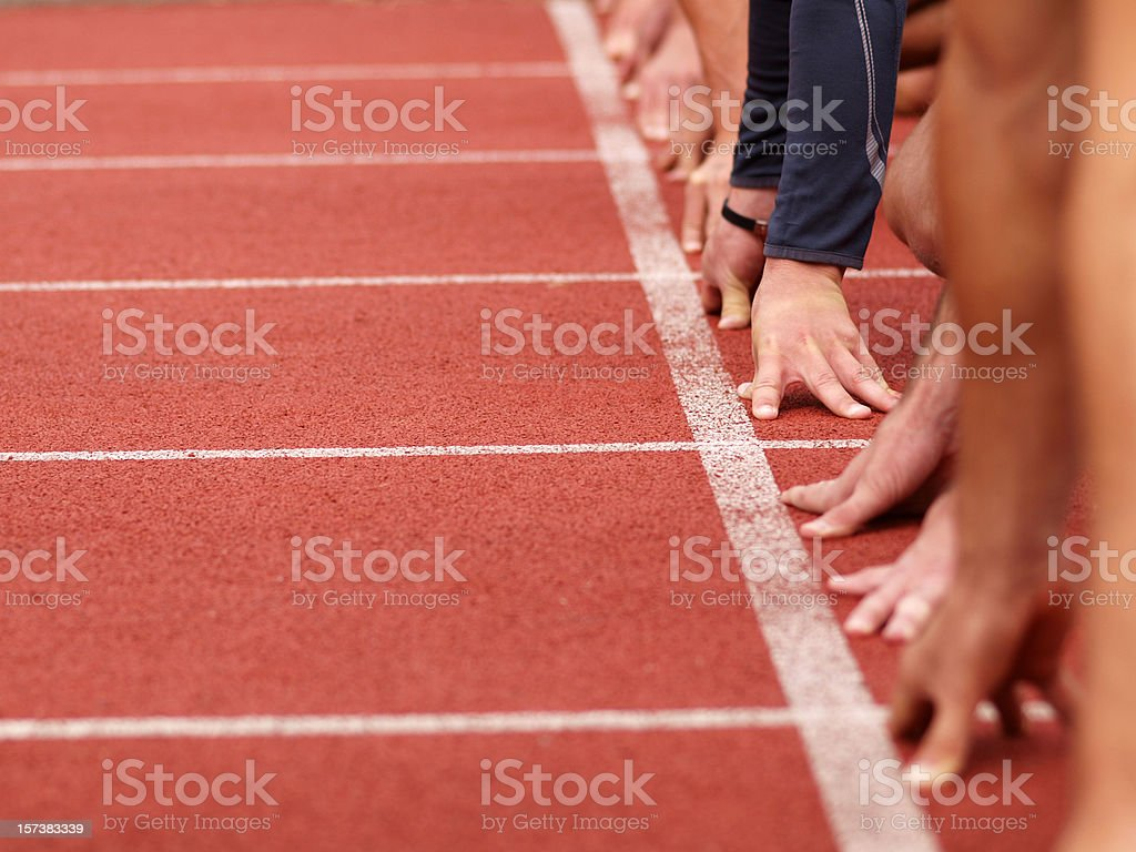 Hands on starting line stock photo