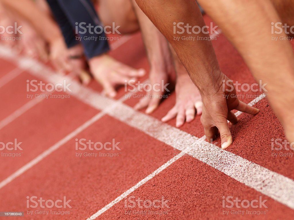 Hands on starting line royalty-free stock photo