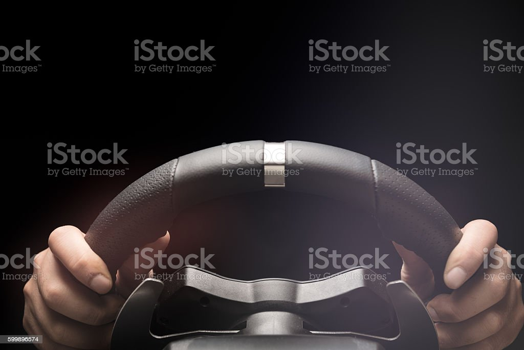 Hands on steering wheel of a car stock photo