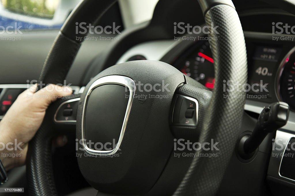 Hands on steering wheel royalty-free stock photo