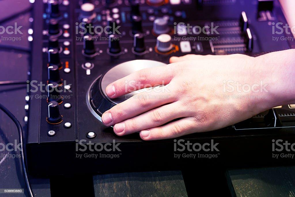 hands on the DJ decks stock photo