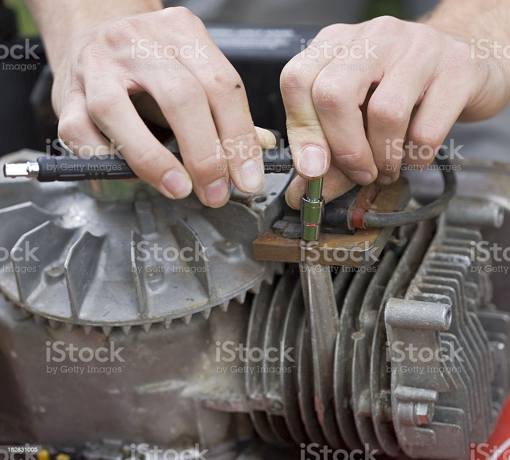 Hands on the engine royalty-free stock photo