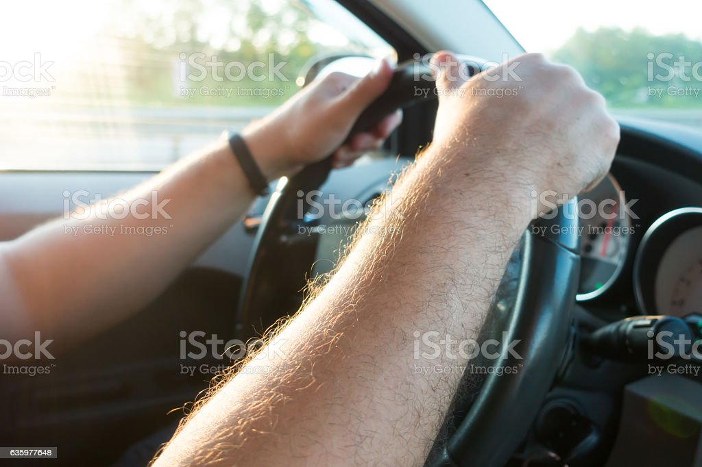 Hands on the steering wheel  of the car driver stock photo