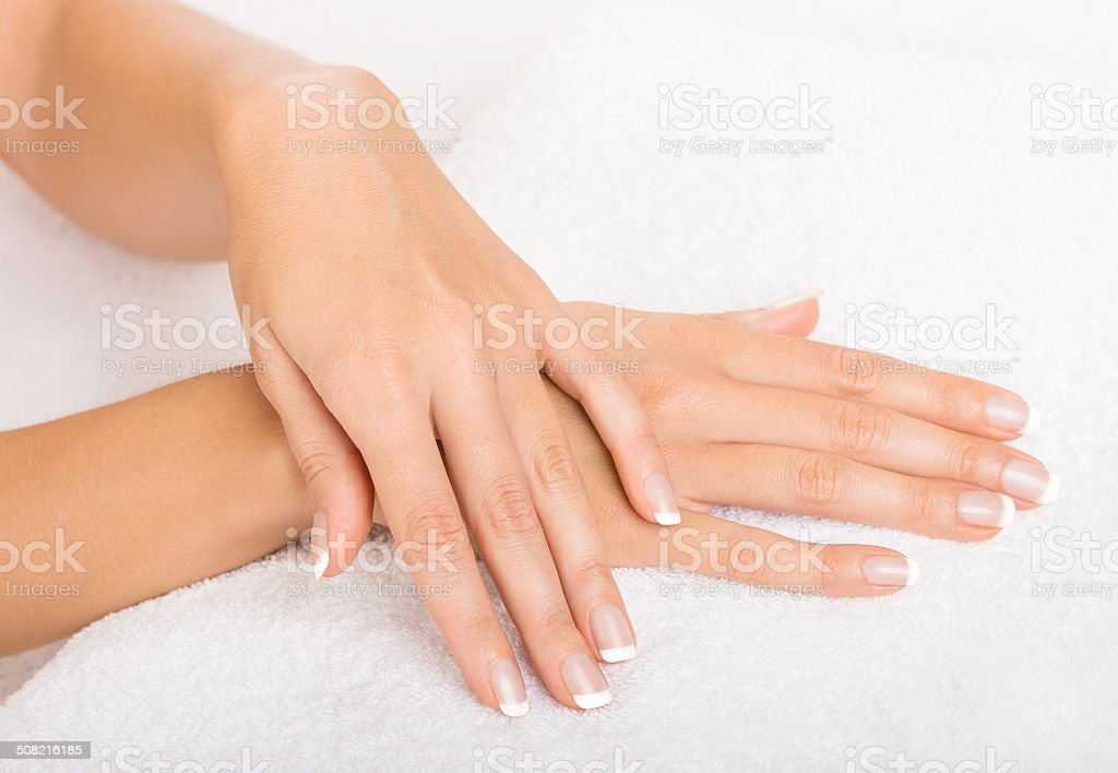 Hands on towel - Manicure stock photo