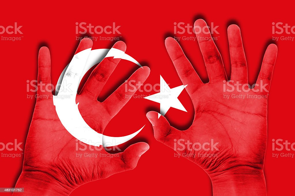 hands on turkey flag background stock photo