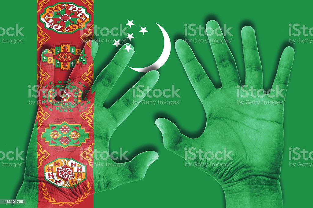 hands on turkmenistan flag background stock photo