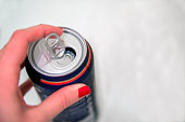 Hands opening a soda (beer) can. Opening aluminum beer can