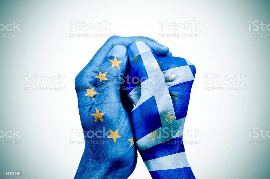 hands patterned with the European and the Greek flag stock photo