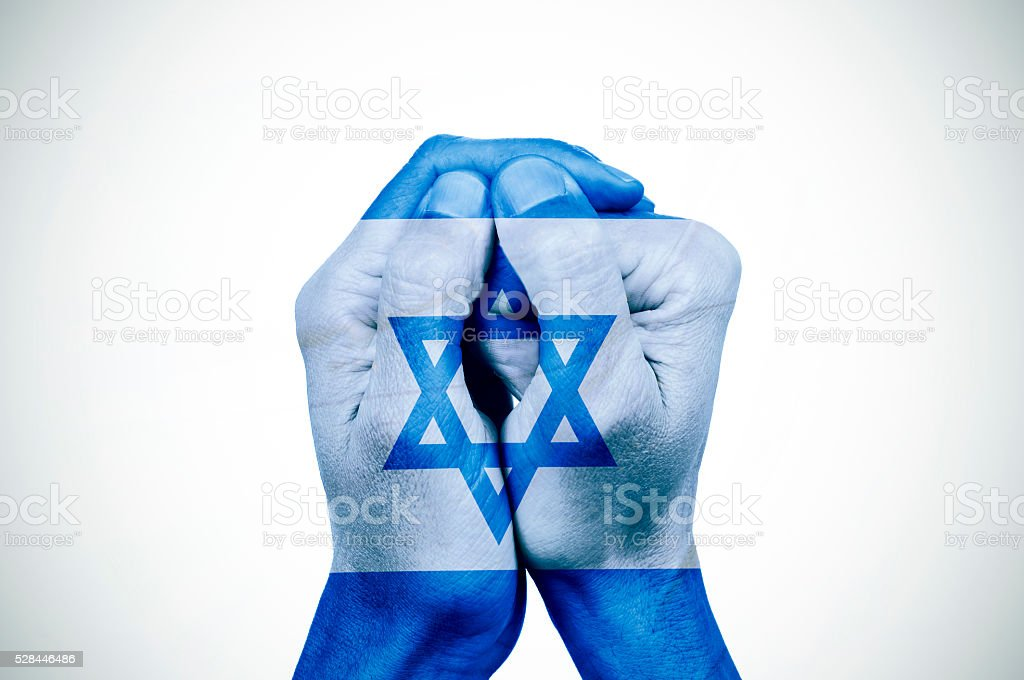 hands patterned with the flag of Israel stock photo