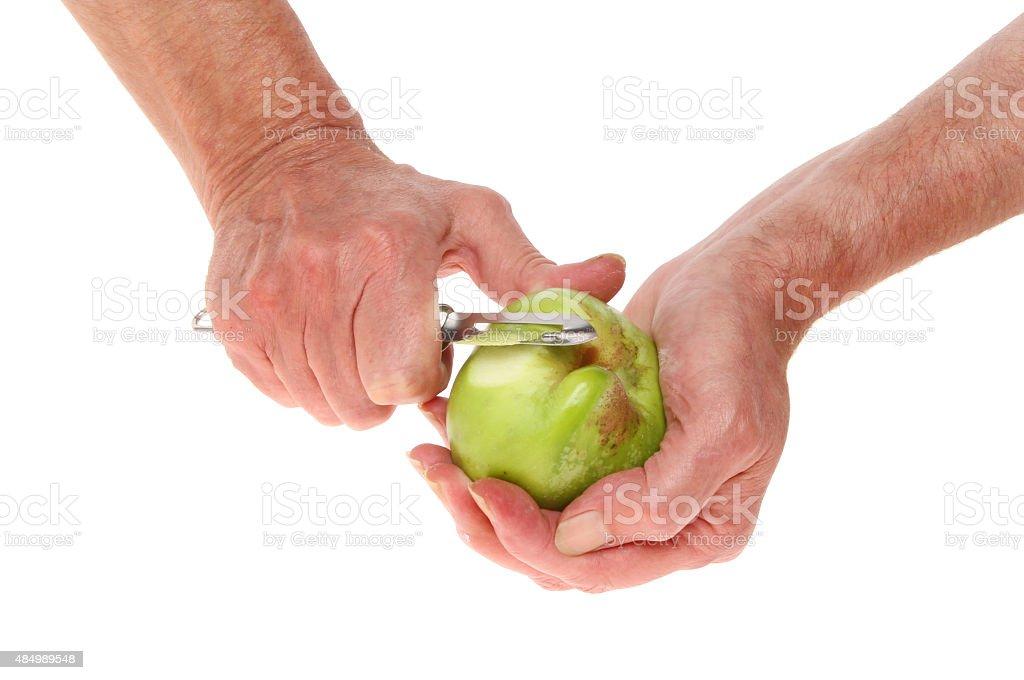 Hands peeling stock photo