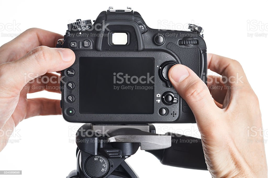 Hands photographer adjust SLR camera isolated stock photo