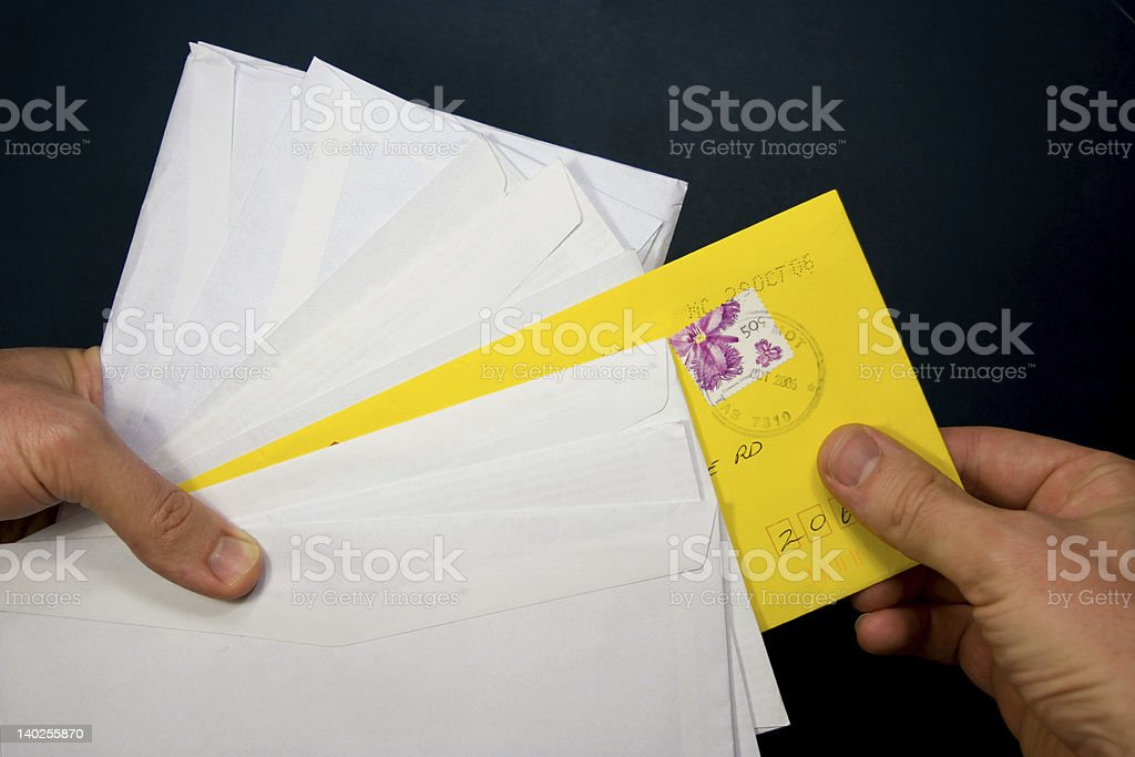 Hands picking a yellow envelope royalty-free stock photo