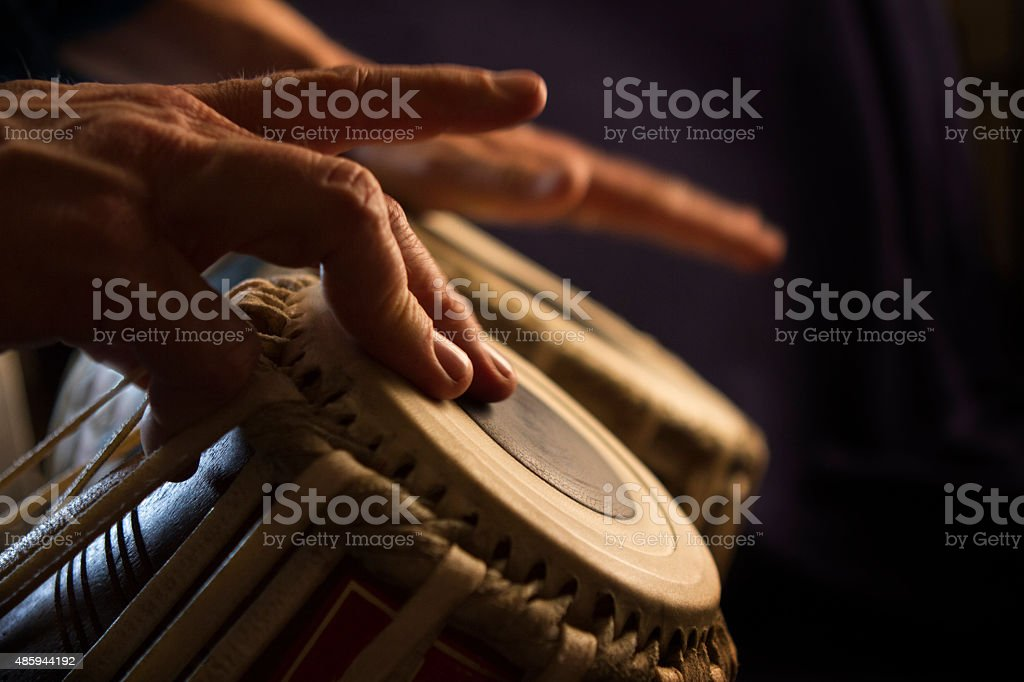 Hands Play Bongos stock photo