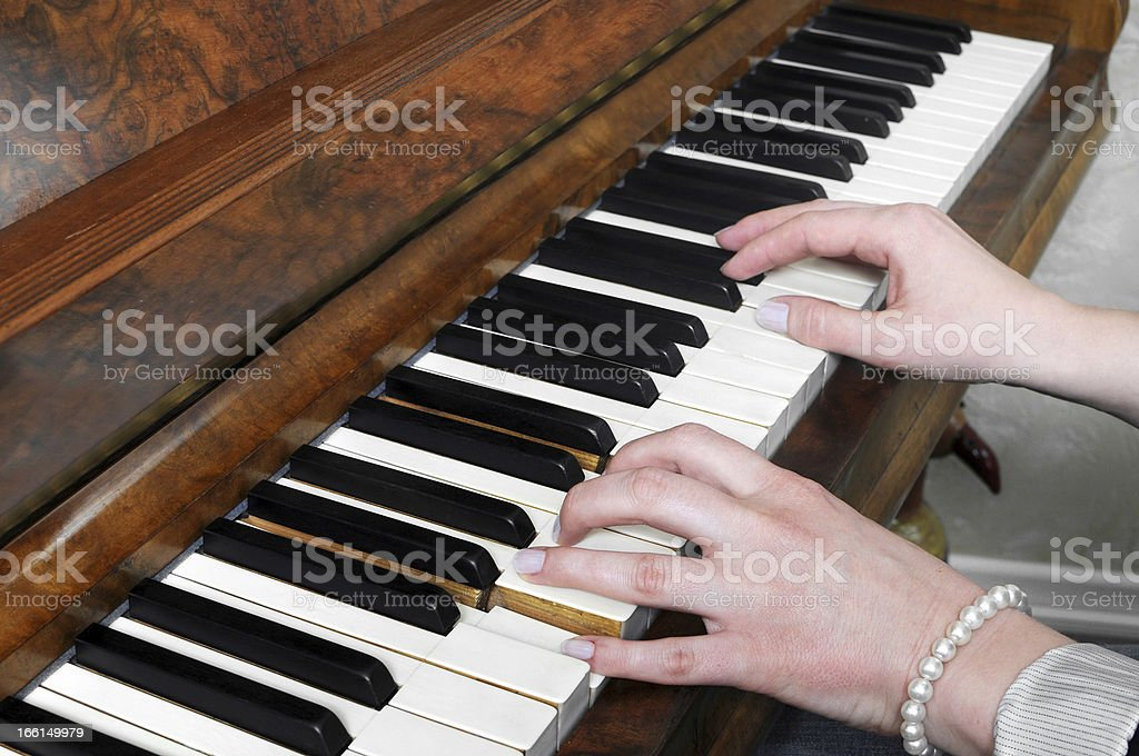 Hands playing antique German piano royalty-free stock photo