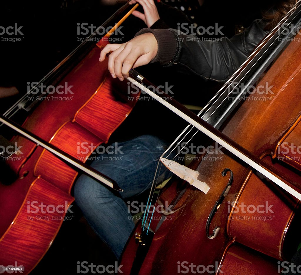 Hands playing cello stock photo