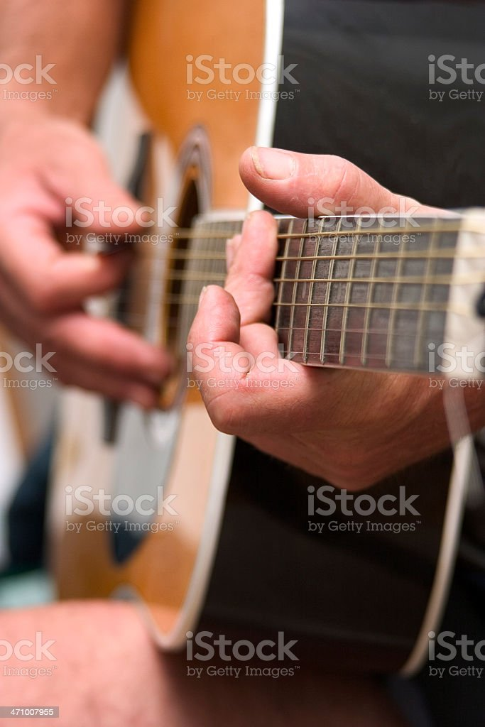 Hands playing guitar royalty-free stock photo
