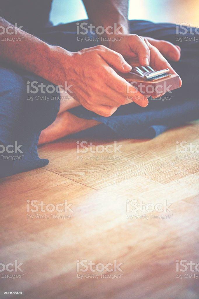 Hands playing little Kalimba stock photo