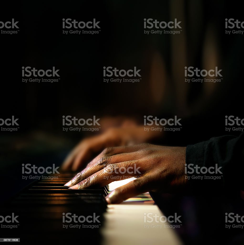 Hands playing piano close-up stock photo