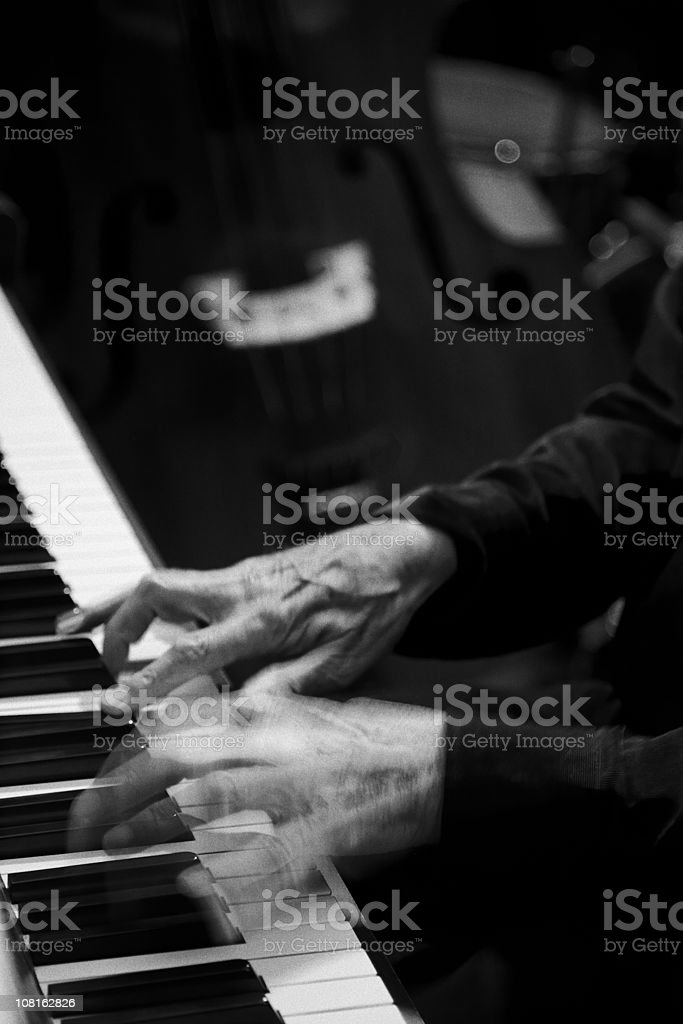 Hands Playing Piano-Black and White-More music/motion blur below stock photo
