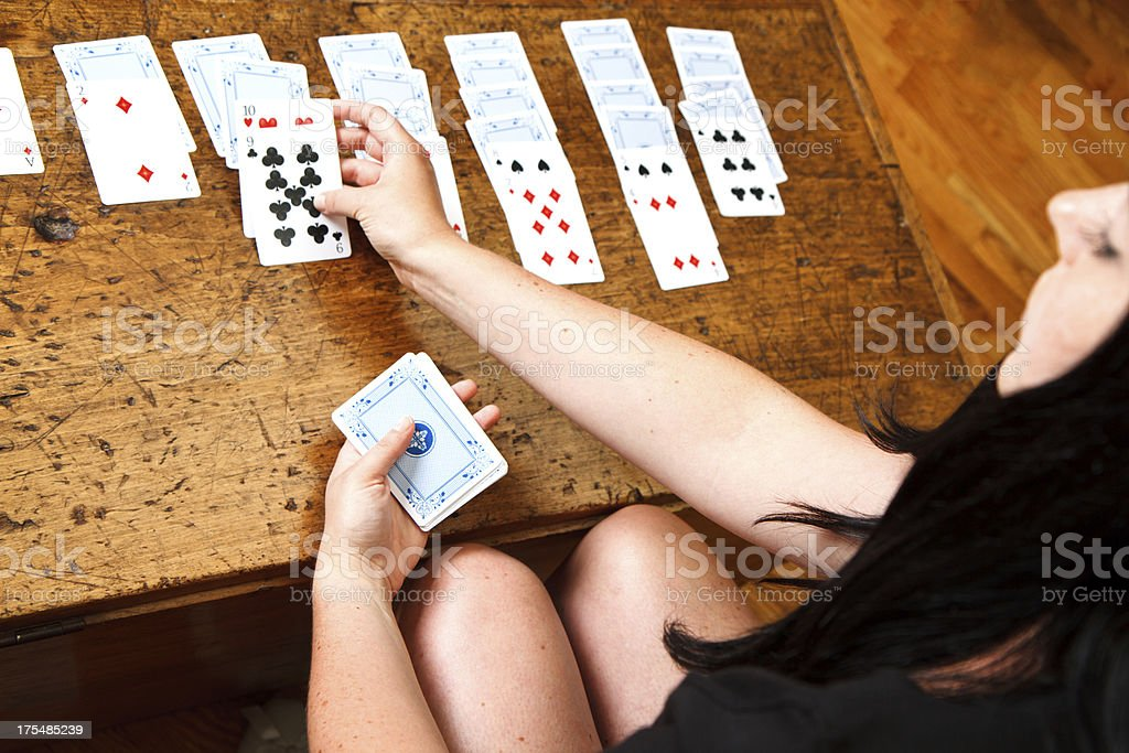 Hands Playing Solitaire Card Game stock photo