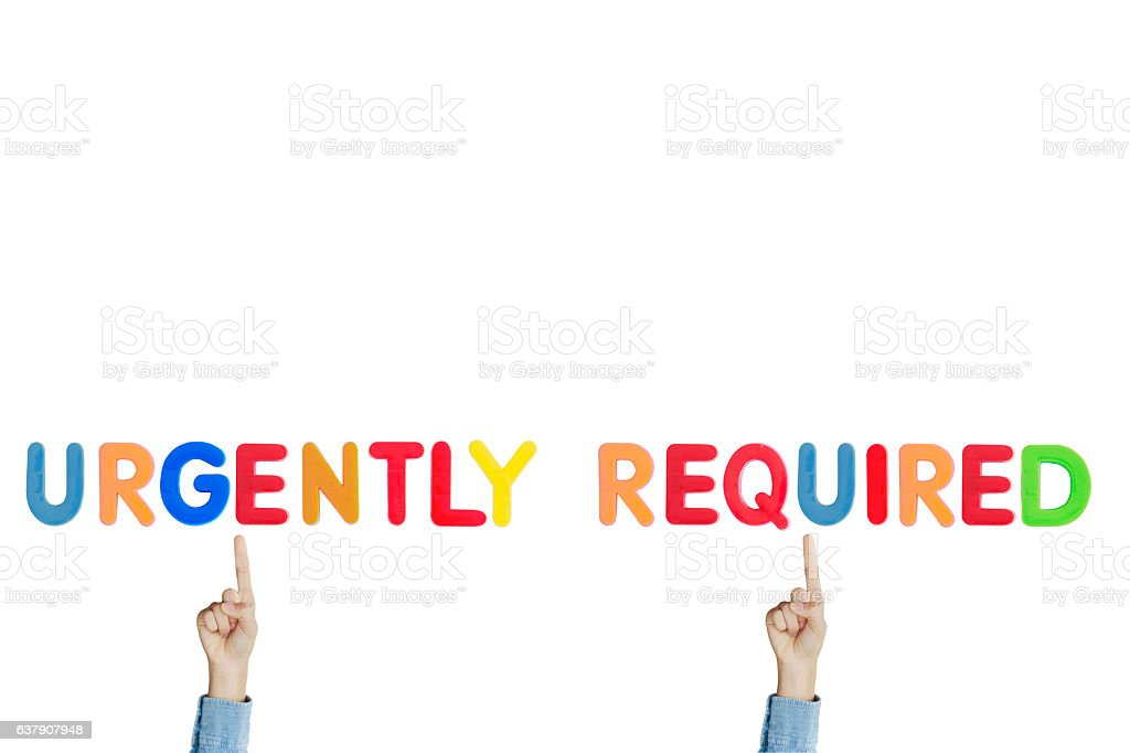Hands point to wording 'UGRGENTLY REQUIRED' stock photo