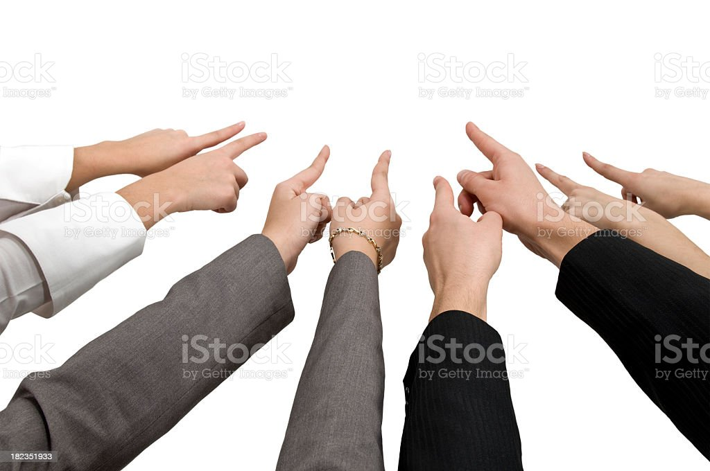 Hands pointing to a central point stock photo