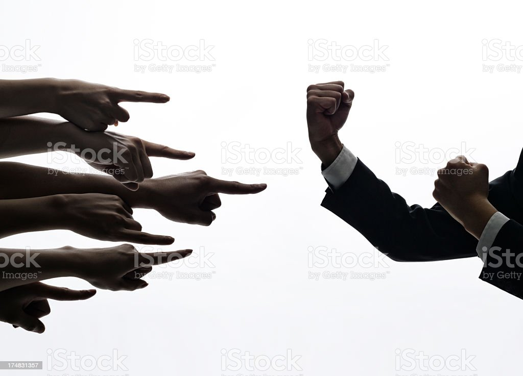 Hands pointing to the strong arm of man. stock photo