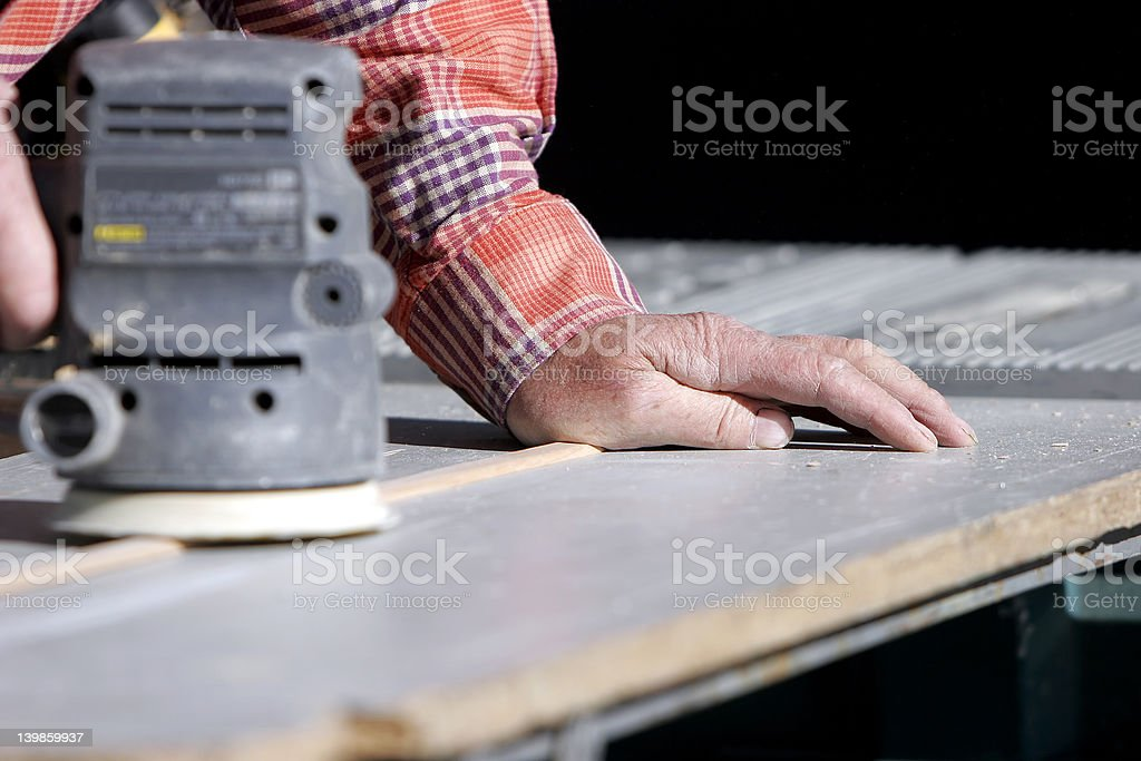 Hands, Power Tool, & Workbench royalty-free stock photo