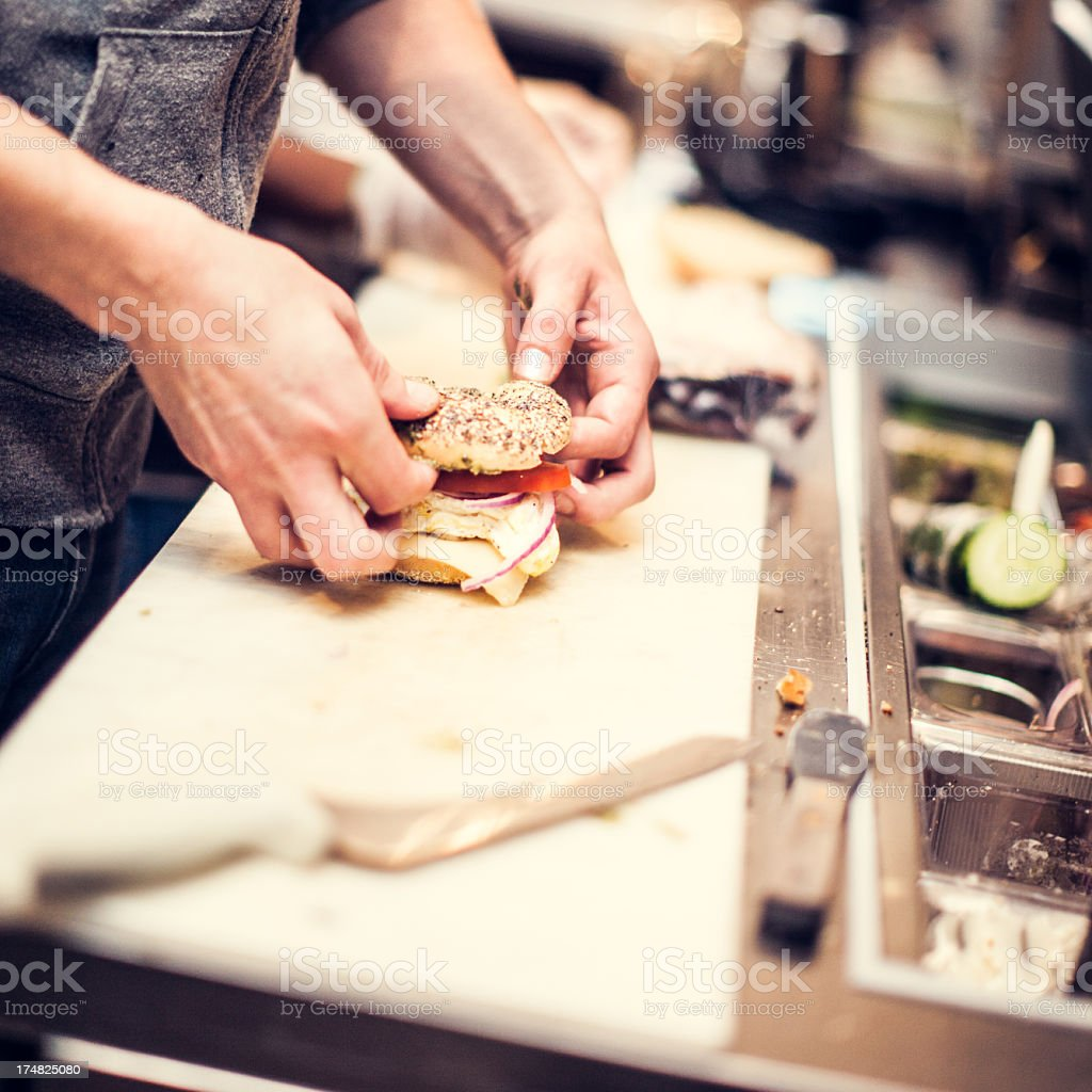 Hands Preparing Food at Deli stock photo