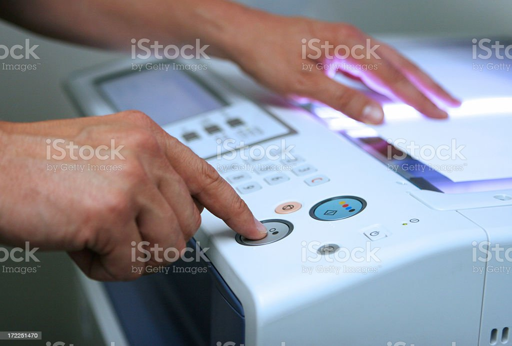 Hands pressing the black-and-white button on a copy machine stock photo