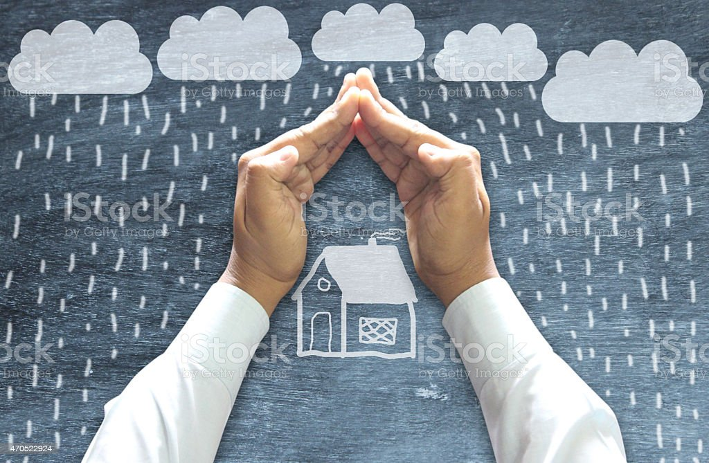 Hands Protecting House stock photo