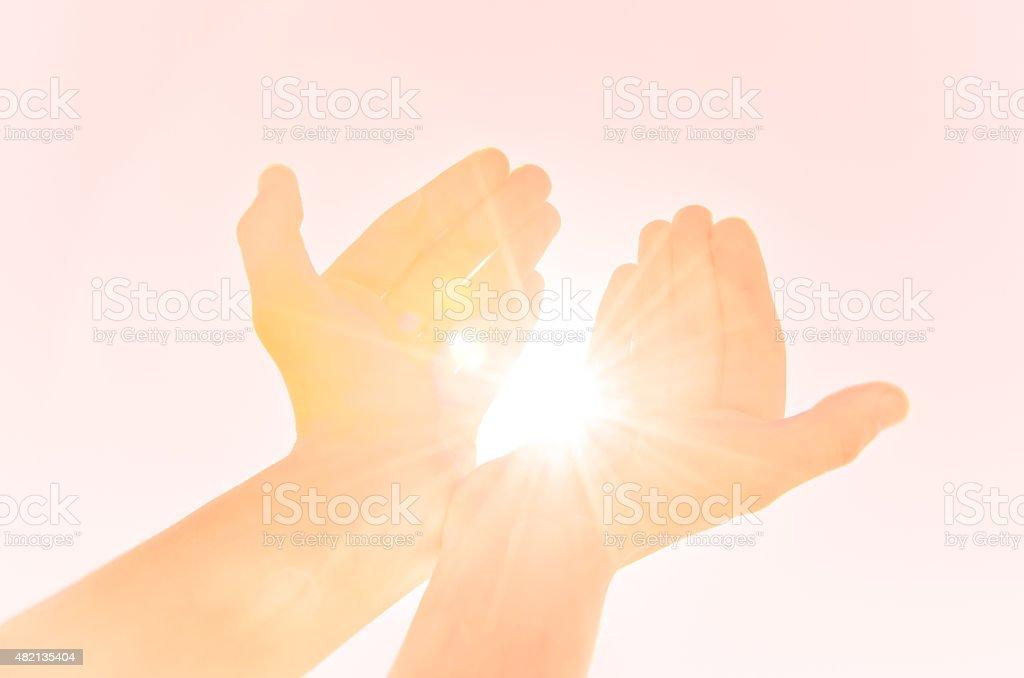 Hands providing light stock photo