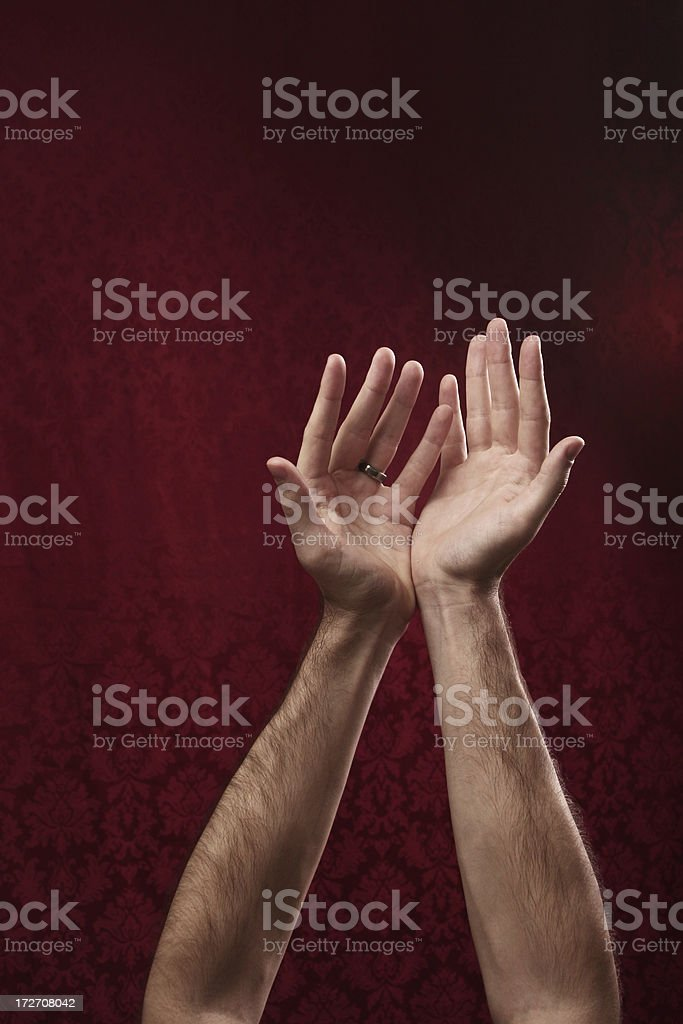 Hands Raised against Red Background royalty-free stock photo