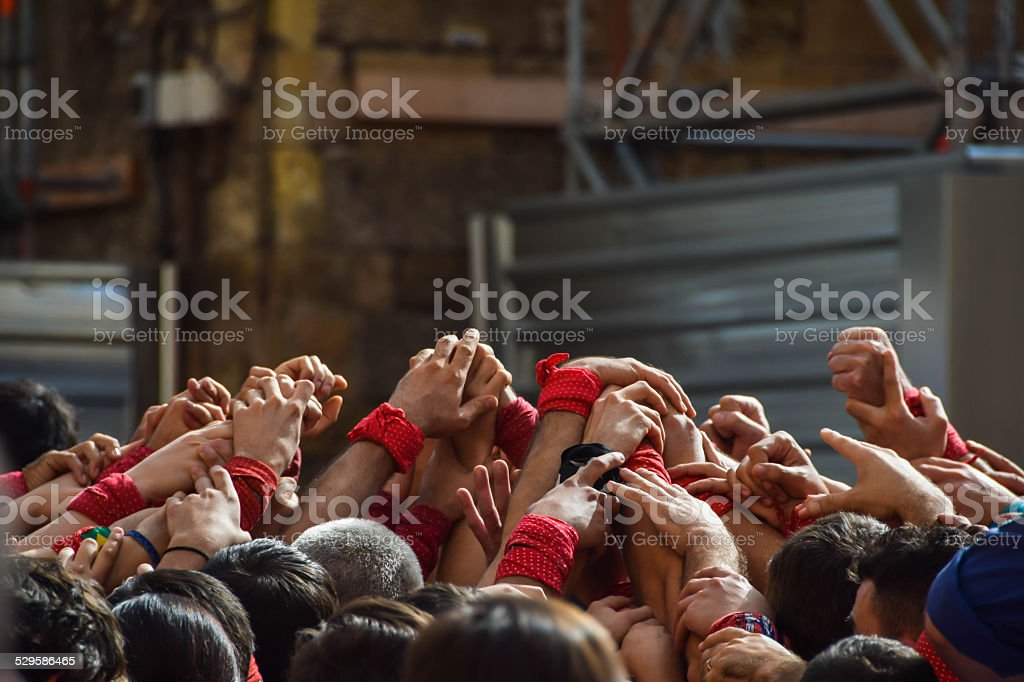 Hands Raised Together. Castellers, Catalunya (Spain) stock photo