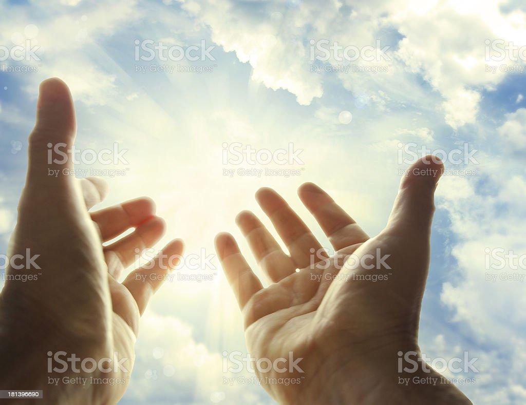 Hands raised towards the sky royalty-free stock photo