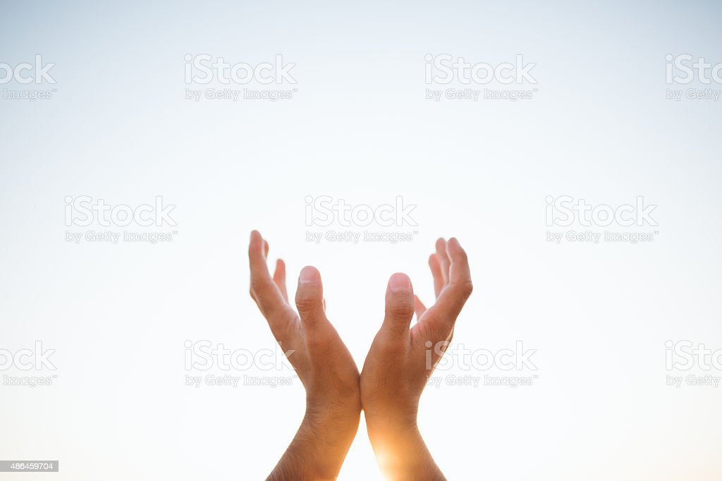 Hands raised up stock photo