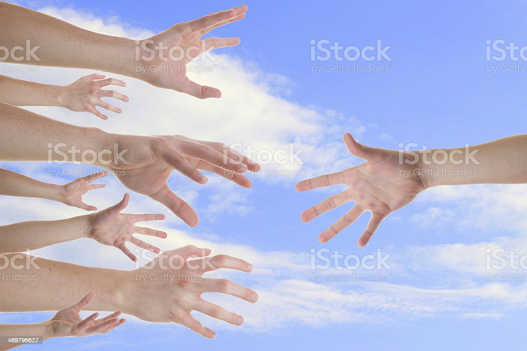 Hands reaching for a helping hand stock photo