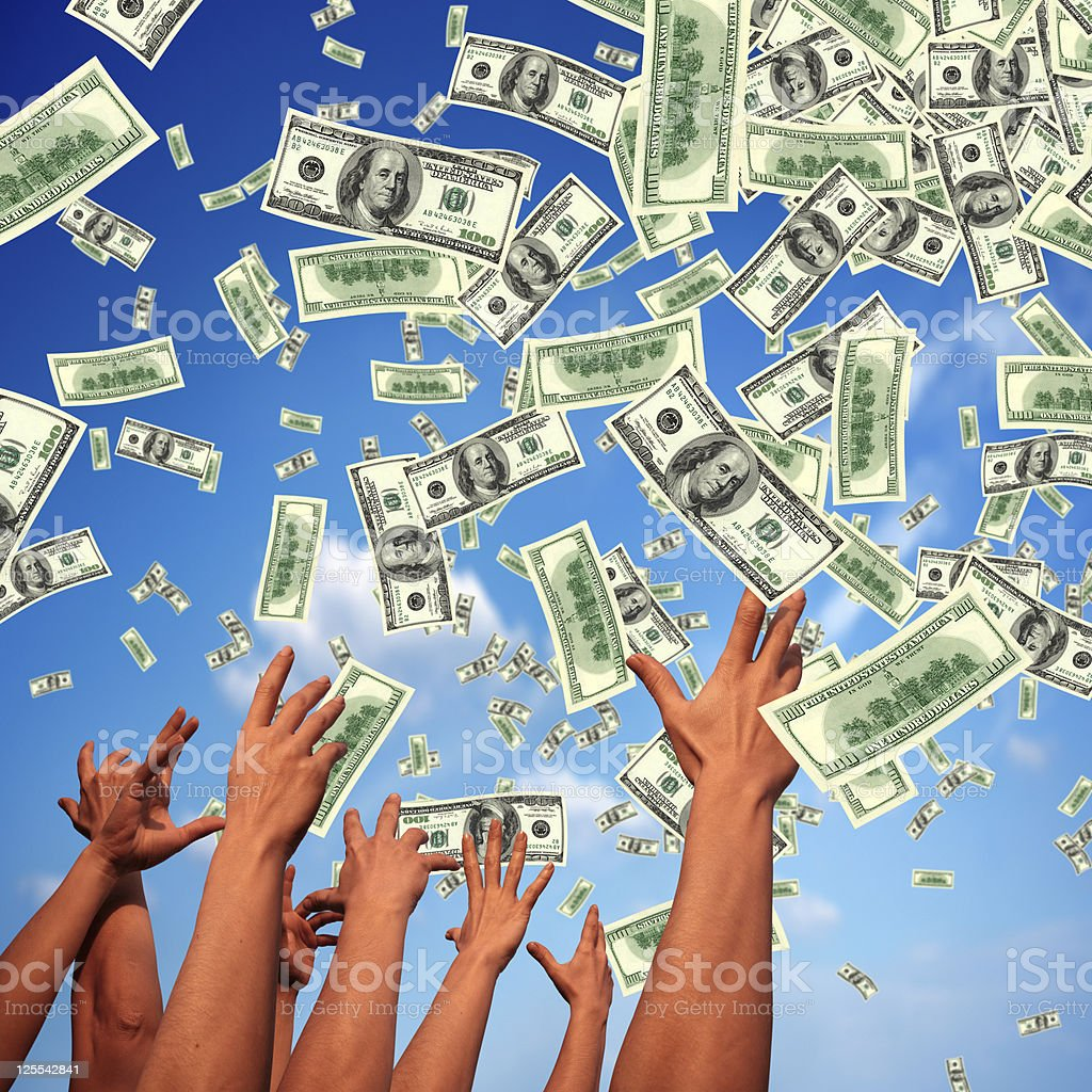 hands reaching to falling money royalty-free stock photo