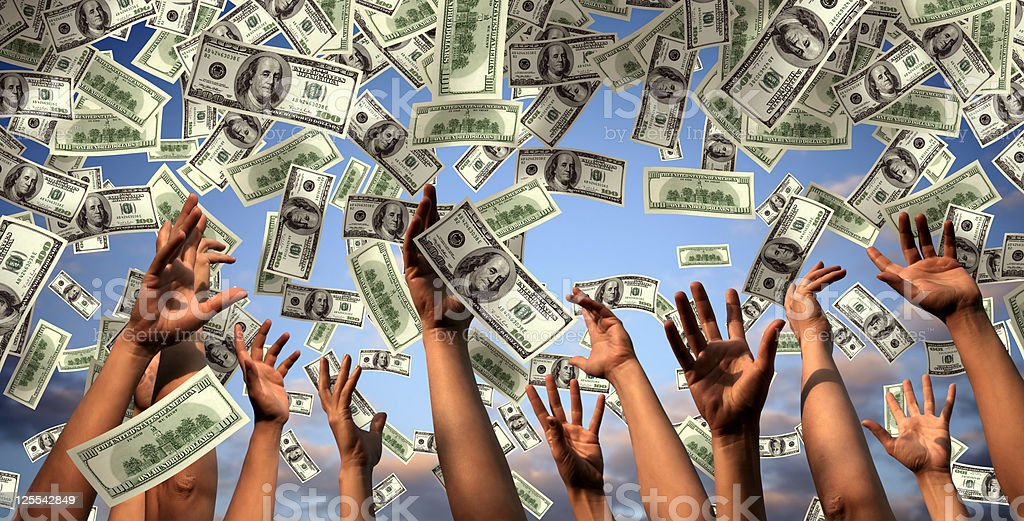 hands reaching to falling money stock photo