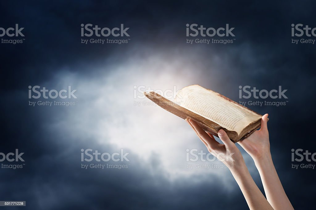 hands reading a book stock photo